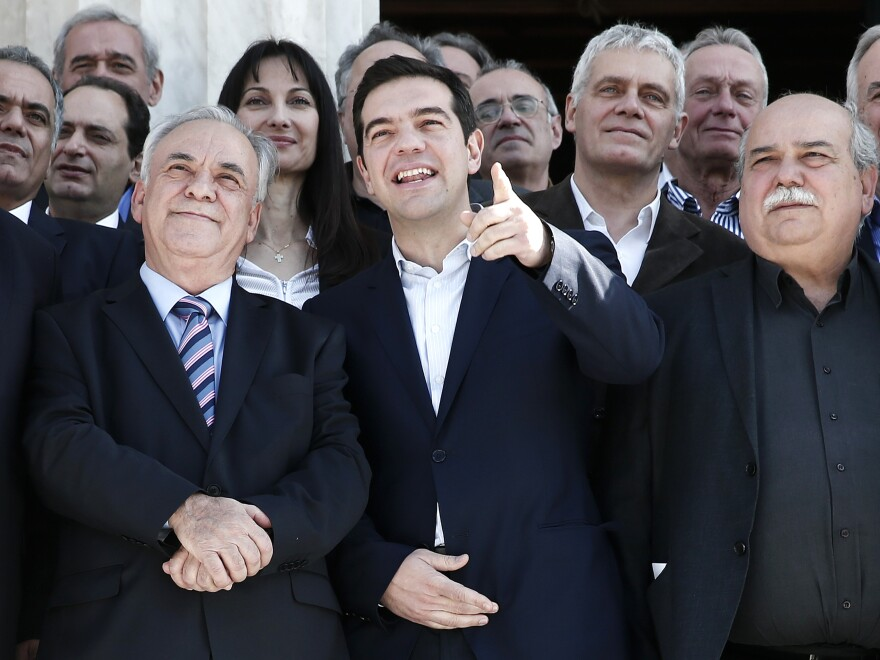 Greek Prime Minister Alexis Tsipras (center) gestures next to Deputy Prime Minister Yannis Dragasakis (left) and Interior and Administrative Reconstruction Minister Nikos Voutsis. Voutsis says Greece may miss its next debt payment.