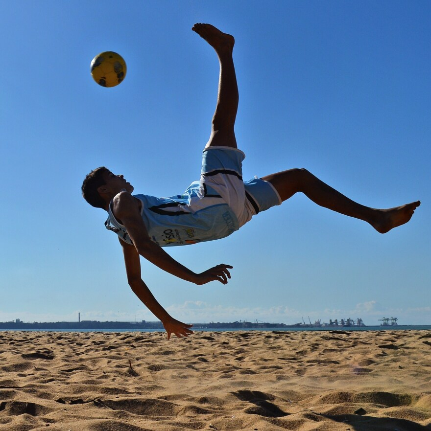 Gearing Up: A Brazilian soccer player practices a bicycle kick in 2014.