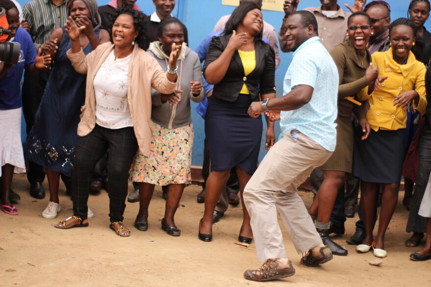 Kennedy Odede (in blue shirt) is dancing for a good reason. The charity he and his wife started has been awarded the $2 million Hilton Humanitarian Prize. He's joined by residents of Kibera, the neighborhood in Nairobi where his nonprofit group provides educational, health and clean water services.