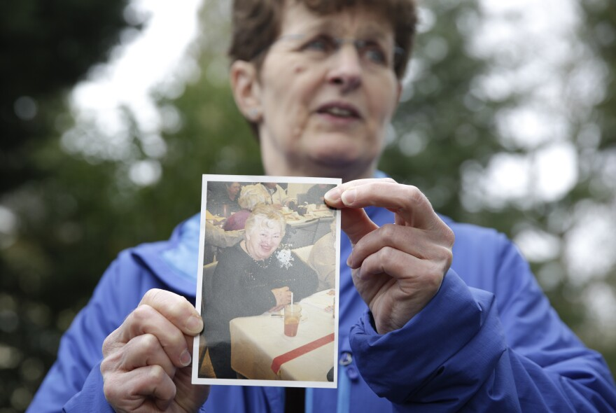 Pat Herrick holds a photo of her mom, Elaine Herrick, 89, a resident of Life Care Center who died of complications from COVID-19. The nursing home in Kirkland, Wash., was the site of one of the first coronavirus outbreaks in the United States.