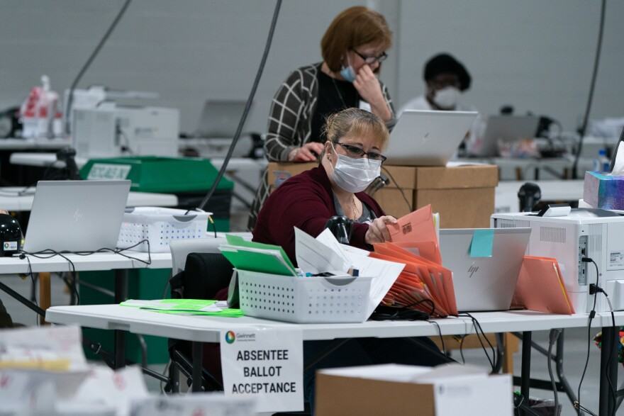 Election personnel sort ballots in preparation for an audit at the Gwinnett County Board of Voter Registrations and Elections offices on November 7, 2020 in Lawrenceville, Ga. President Trump's attempt at legal action to contest the results of the election have so far been mostly unsuccessful.