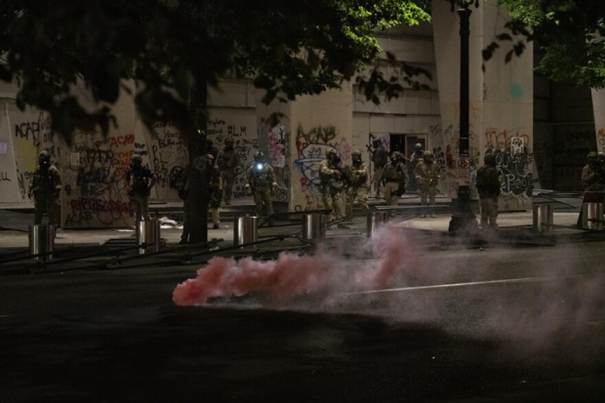 Federal officers deploy tear gas against people protesting racism and police violence in front of the Mark O. Hatfield federal courthouse in Portland, Ore., on July 18, 2020. The federal police presence in Portland has galvanized protesters, bringing out larger crowds than in preceding weeks.