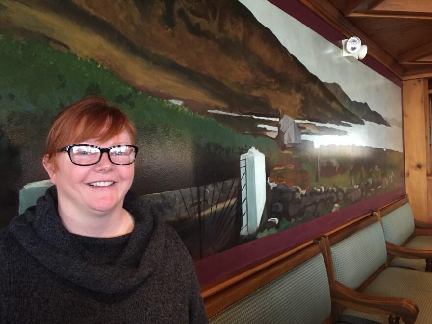 Karen O'Malley with mural