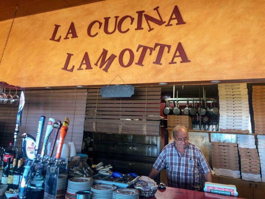 Sal LaMotta folds pizza boxes in the kitchen of LaMotta's Italian Restaurant in Fort Myers.