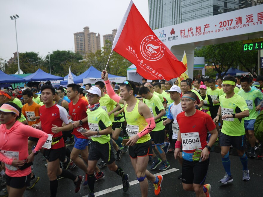 Runners begin the third annual Qingyuan marathon, held on March 19. Runners competed in half- and full-marathon races.