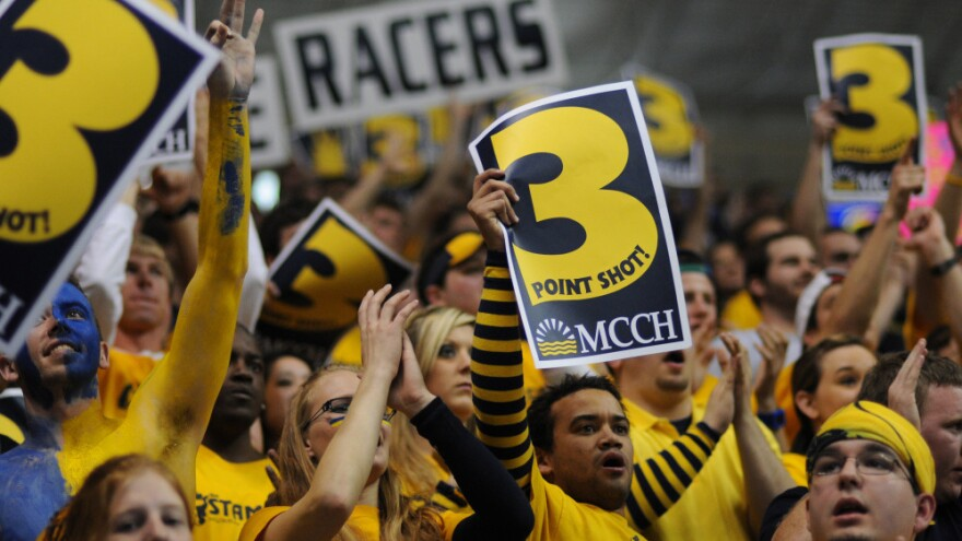 Murray State fans celebrate a 3-point shot by Murray State's Donte Poole during the first half of a game St. Mary's on Feb. 18. Since January, every Racers home game has sold out.