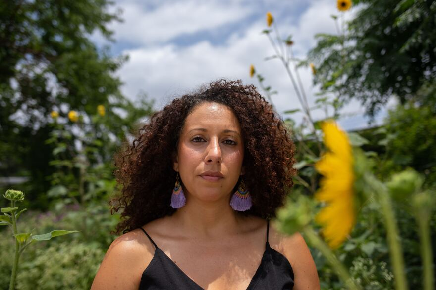 Sara Mokuria, the co-founder of Mothers Against Police Brutality, is seen in a garden of sunflowers.