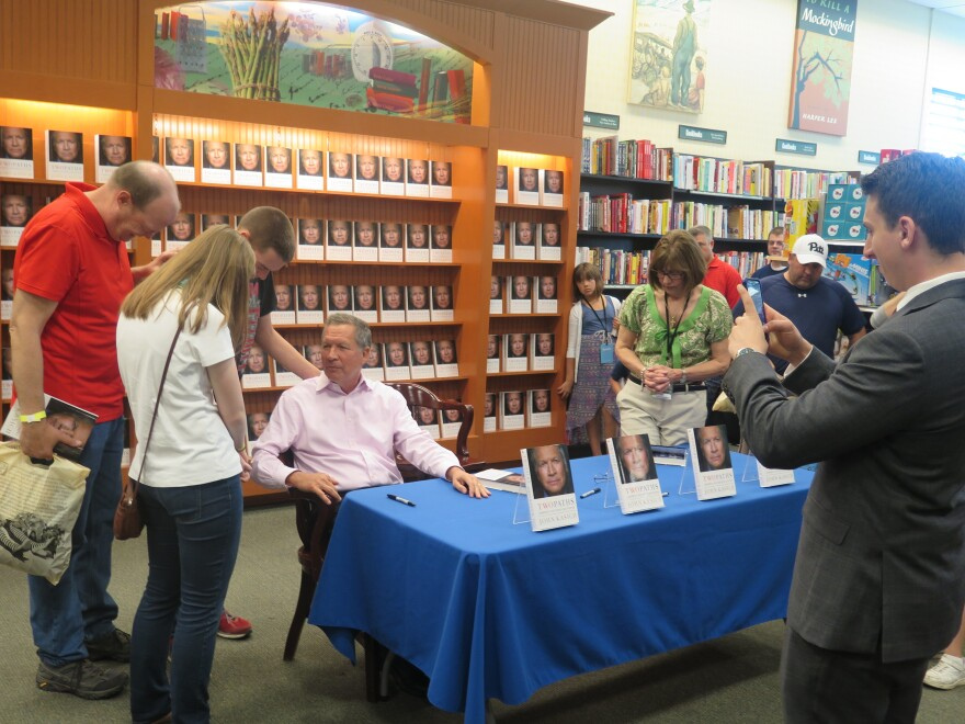 photo of Gov. John Kasich at a book signing