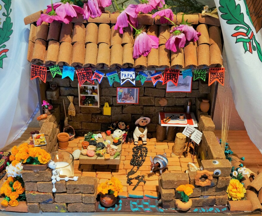 Pickett made an ofrenda for her father this year. All of the photos and objects, even the building materials, have special significance.