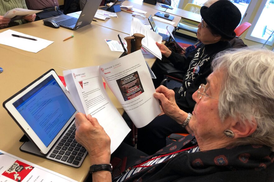 Marlene Cianci looks at a meme about the census. The workshop helps seniors parse the source of an article, fact-check a claim online and discern propaganda from reputable sources.