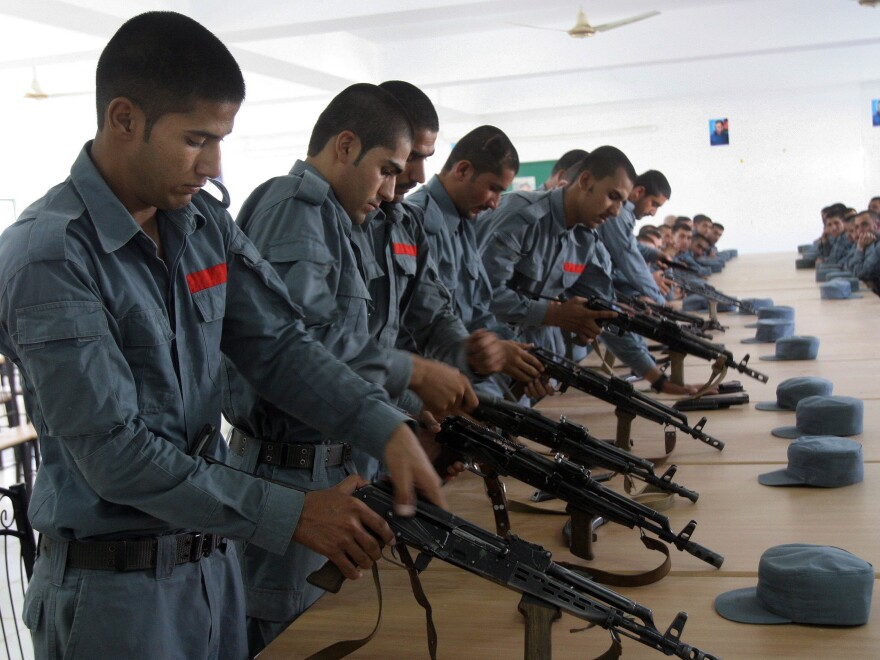 Afghan police train with their weapons in Lashkar Gah, Afghanistan, in July. Hundreds of U.S. troops are deployed to train and assist security forces in Helmand province, where the Taliban have recently made territorial gains.