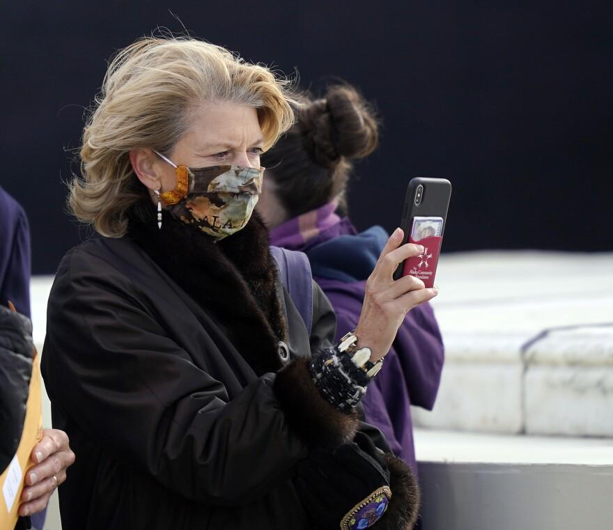 Sen. Lisa Murkowski, R-Alaska, arrives Wednesday at the U.S. Capitol for the inauguration of President Biden.