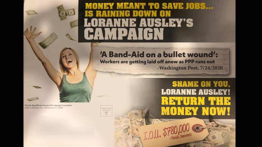 """Slip of paper that reads, """"Money meant to save jobs... is raining down on Loranne Ausley's campaign. Shame on you Loranne Ausley! Return the money now!"""""""
