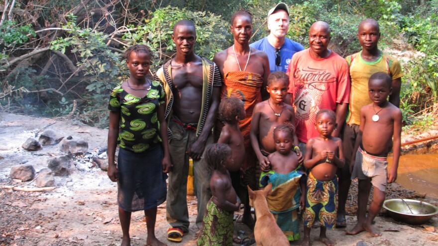 Dr. Daniel Bausch (in blue T-shirt) has spent years studying Ebola. In April, he went to Guinea, where the current outbreak began.