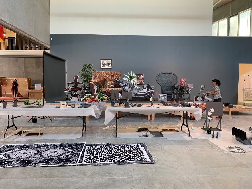 """Stephanie Syjuco, seen far right, puts together an installation for """"Rogue States,"""" her exhibition at CAM. [9/13/19]"""