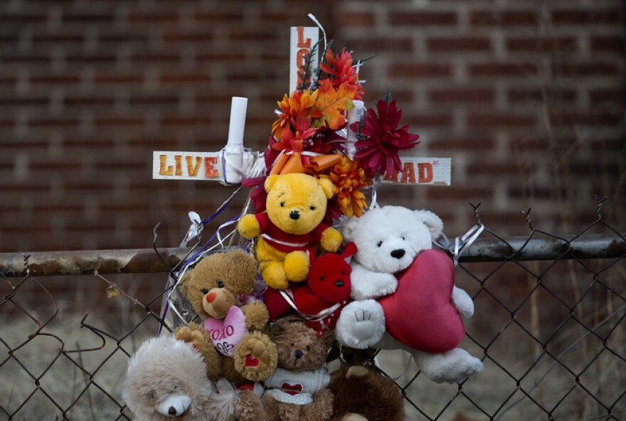 A memorial rests for Rashad Farmer, who was shot and killed in 2015 on the 5800 block of Lotus Avenue in St. Louis.