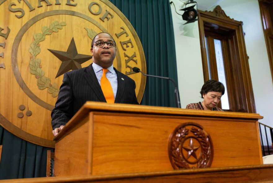 State Rep. Eric Johnson, D-Dallas, is joined by state Rep. Angie Button, R-Richardson, during a press conference at the Capitol to announce an anti-corruption bill Monday.