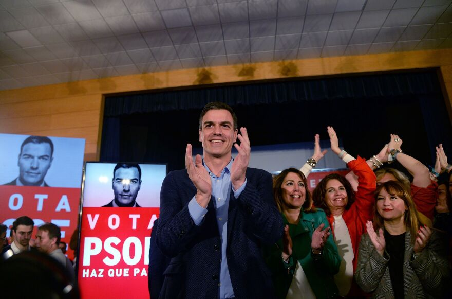 Spanish Prime Minister Pedro Sánchez applauds after presenting his campaign poster during a rally to officially launch the Spanish Socialist Party's electoral campaign in Seville on April 11. General elections are on Sunday.