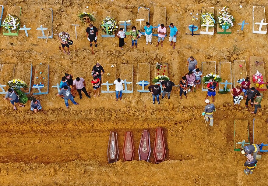 Aerial picture of a burial at the Nossa Senhora Aparecida cemetery in Manaus, in the Amazon forest in Brazil. COVID-19 cases have surged in the area.