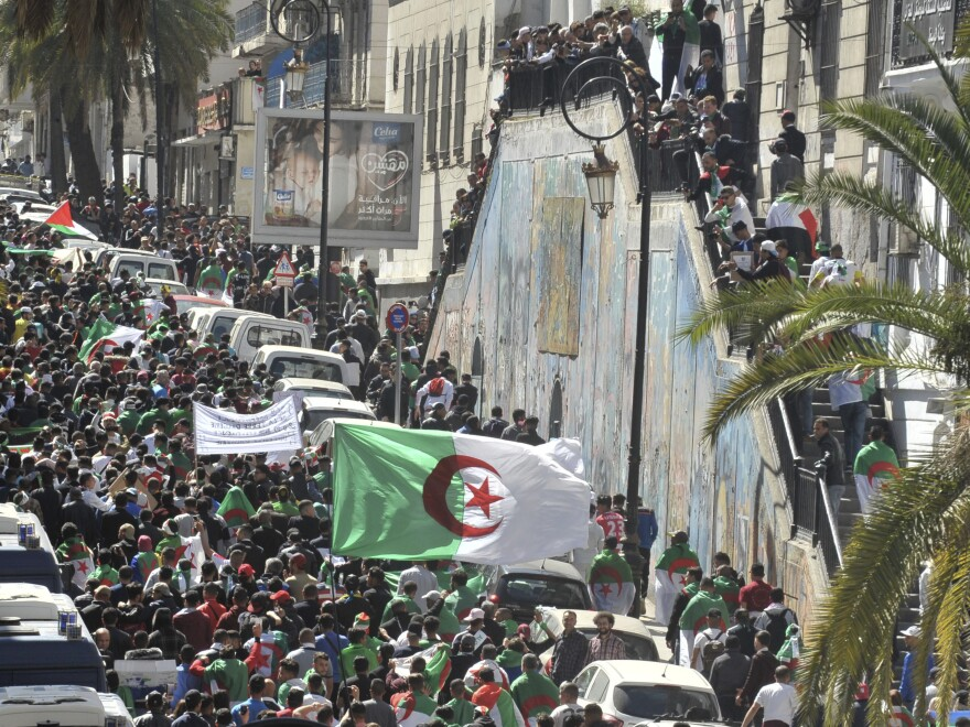 Protesters march in Algiers, Algeria, on Friday against President Abdelaziz Bouteflika.