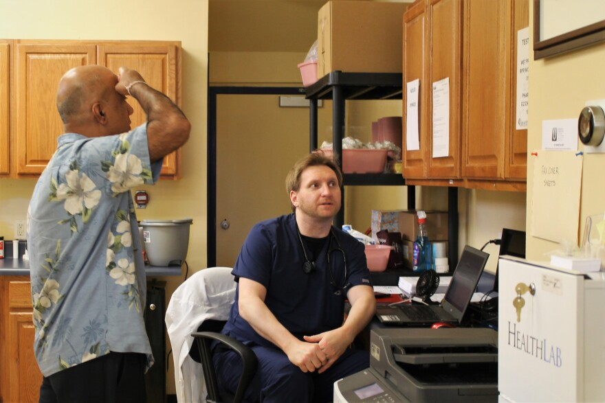 Physician Sonny Saggar, left, nurse practitioner Michael Zappulla discuss the day's plans at North City Urgent Care, one of two urgent care clinics in north St. Louis.
