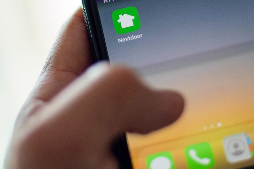 Nextdoor, the hyper local social network, is seen on a smartphone screen in Washington, DC.