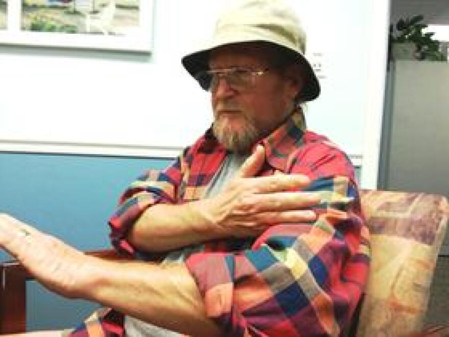 Doug Warner demonstrates how far an infection rose on his arm.