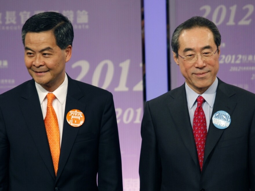 Former convener of Hong Kong's Executive Council Leung Chun-ying (left) and former Hong Kong Chief Secretary Henry Tang (shown here March 16) are the leading candidates to be Hong Kong's next leader, who will be chosen March 25 by a Beijing-selected committee.