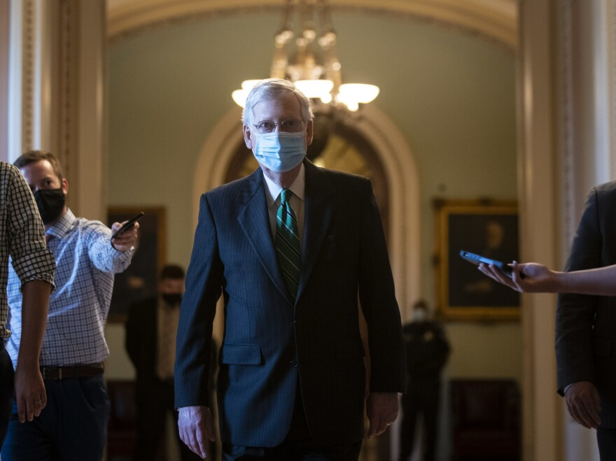Senate Majority Leader Mitch McConnell walks back to his office after delivering opening remarks at the U.S Capitol on Wednesday.