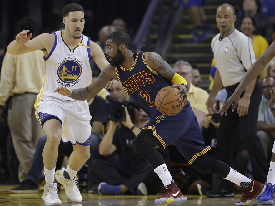 Cleveland Cavaliers guard Kyrie Irving (2) drives against Golden State Warriors guard Klay Thompson (11) during the first half of Game 1 of basketball's NBA Finals in Oakland, Calif.