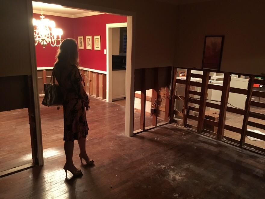 Mary Wilkins stands inside her damaged house in Houston's Meyerland neighborhood.