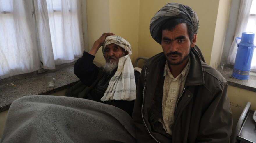 <p>Afghan men wait to receive psychiatric treatment in a Kabul hospital. Scarred by decades of war, social problems and poverty, more than 60 percent of Afghans suffer from stress disorders and mental health problems.</p>