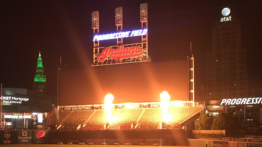 The team's 105-year old nickname is illuminated at Progressive Field as post-game fireworks kick off in July 2019. The process to change the name of Cleveland's baseball team may not be complete until the 2022 season.