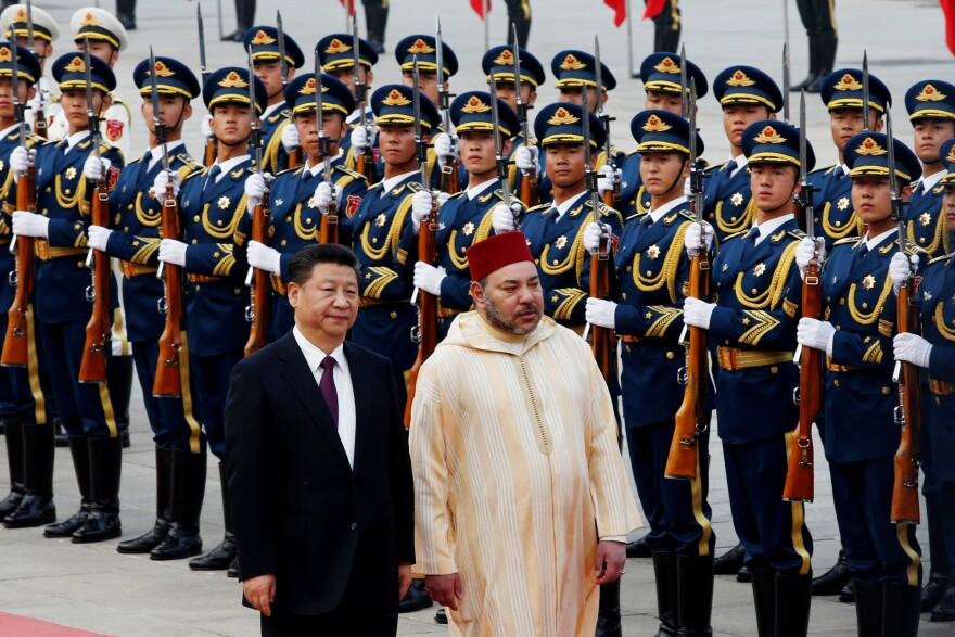 Chinese President Xi Jinping and Moroccan King Mohammed VI walk outside the Great Hall of People in Beijing in May 2016.