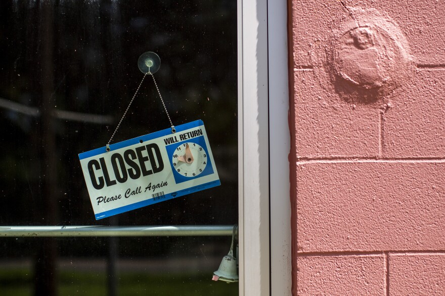 A closed sign is placed on the door of a business in East Austin during the pandemic. Gov. Greg Abbott announced some businesses can reopen with limited capacity on Friday, but not all are choosing to do so.