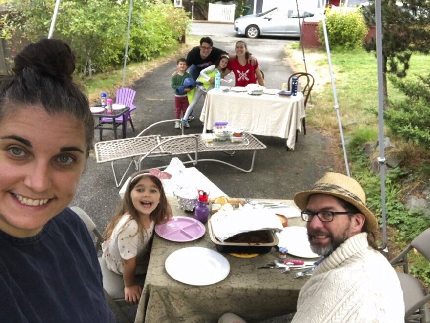 Jennifer Fliss takes a selfie of her and her neighbors in her driveway. Fliss hosted a socially-distances Rosh Hashanah supper.