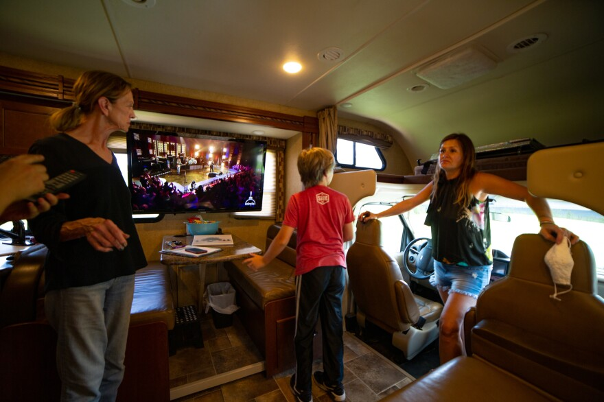 Amy Holditch receives a two-hour tour of the RV, with instructions for how to operate everything inside and out. From left: Sandra Gillis, Duncan Holditch, and Amy Holditch.