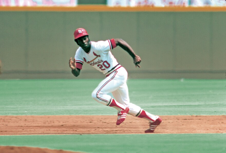 Lou Brock running from one base to the next