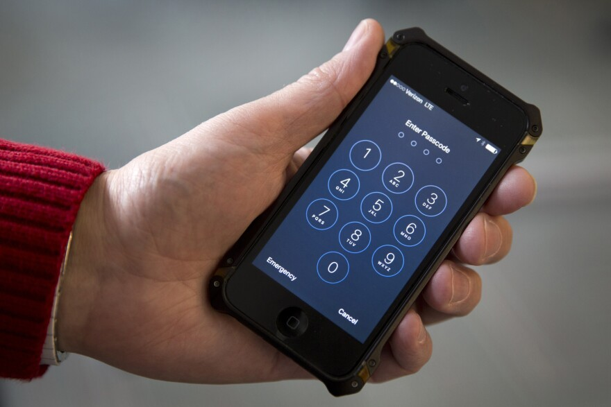 In this Feb. 17, 2016, file photo an iPhone is seen in Washington. A new lawsuit claims the government's practice of searching laptops and cellphones at airports and border crossings is unconstitutional because modern electronic devices carry troves of private information.  (AP Photo/Carolyn Kaster, File)