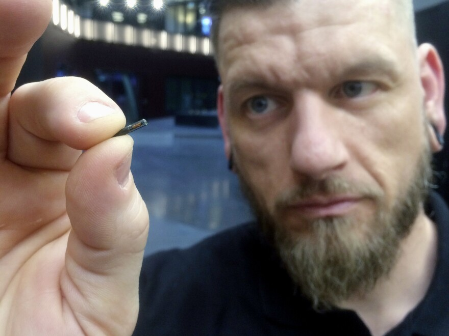 Jowan Osterlund holds a microchip implant in Stockholm in 2017. His company, Biohax International, is a leading provider of the devices in Sweden.