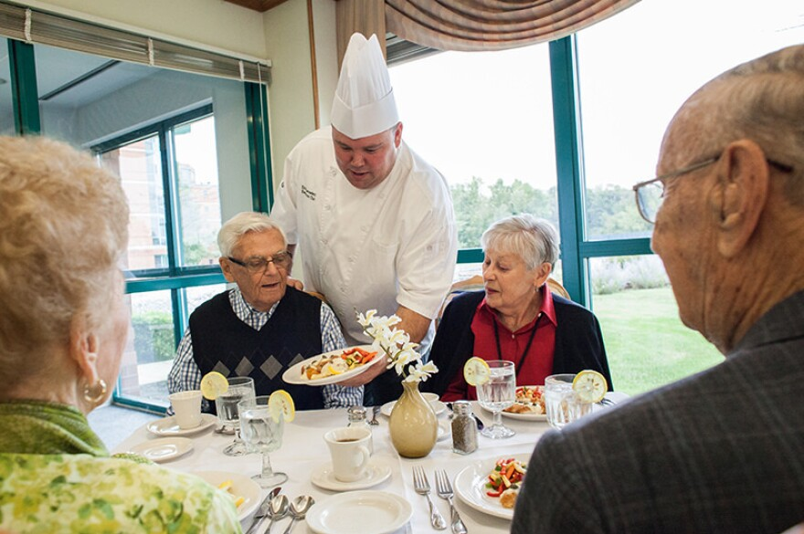 """Chef Eric David Corradetti presents dinner to residents at the <a href=""""http://www.reshealth.org/sub_ss/senior-housing/independent-living/bethlehem-woods-retirement-community.cfm"""">Bethlehem Woods</a> senior living facility in La Grange Park, Ill. His kitchen emphasizes fresh produce and meats and meals made from scratch."""