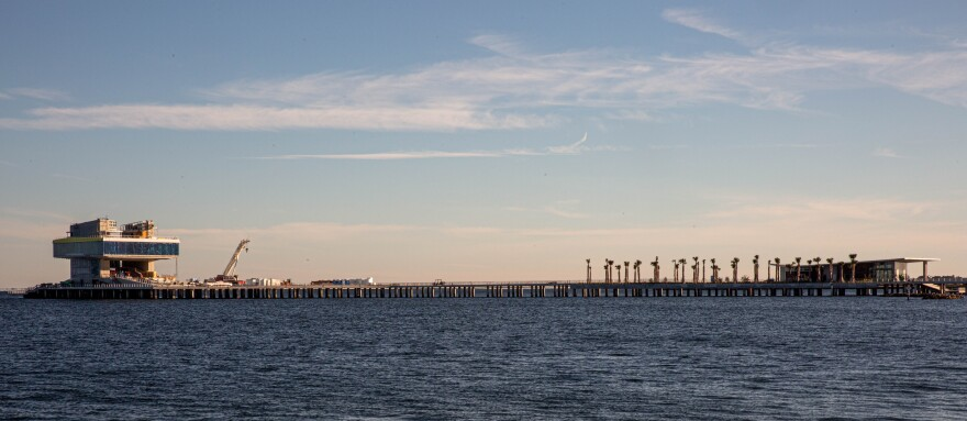 An overview shot from across the water shows the end of the St. Pete Pier.