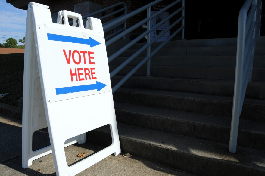bigstock--Vote-here-to-direct-voters-t-18776258.jpg