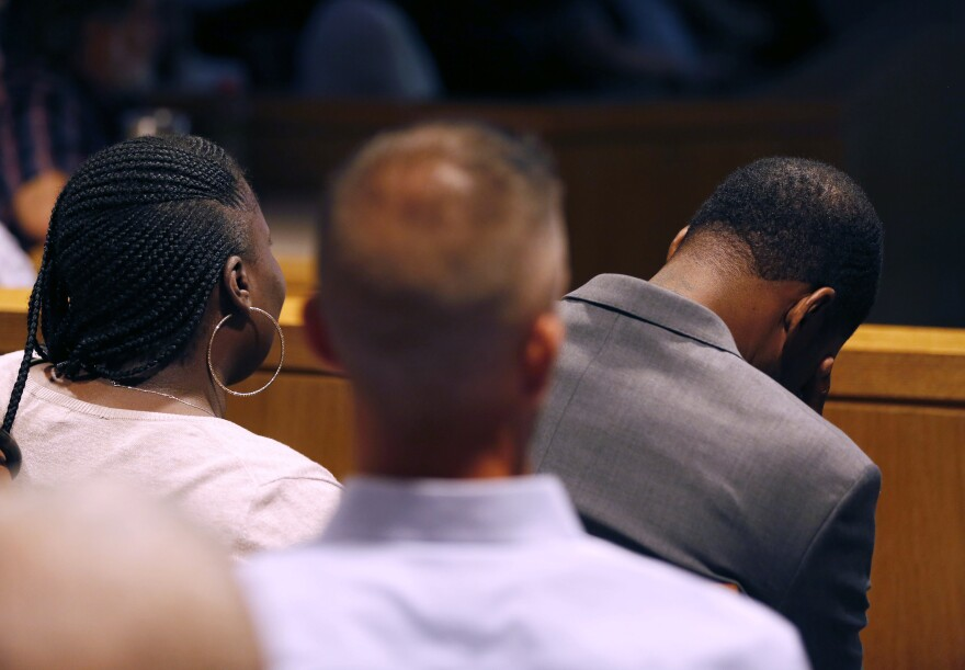 Odell Edwards, father of Jordan Edwards, drops his head to avoid seeing a crime scene photo during a closing argument in the trial of former Balch Springs police officer Roy Oliver at the Frank Crowley Courts Building in Dallas on Aug. 27, 2018.