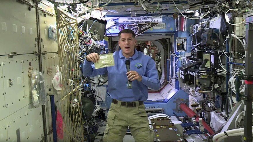 NASA astronaut Shane Kimbrough shows a pouch of turkey he will be preparing for his crew in celebration of the Thanksgiving holiday, aboard the International Space Station.