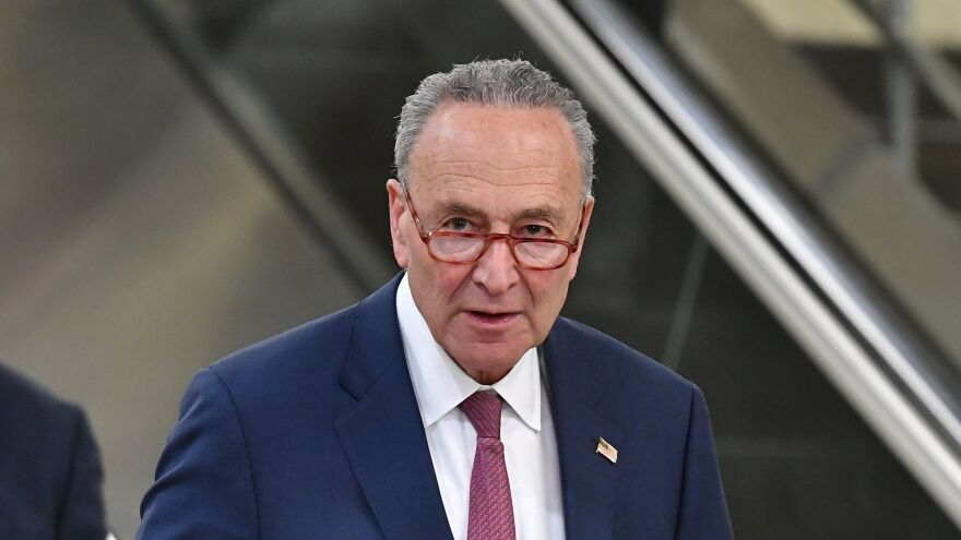 Minority Leader Sen. Chuck Schumer makes his way to speak to reporters during a break in the Senate impeachment proceedings on Friday.