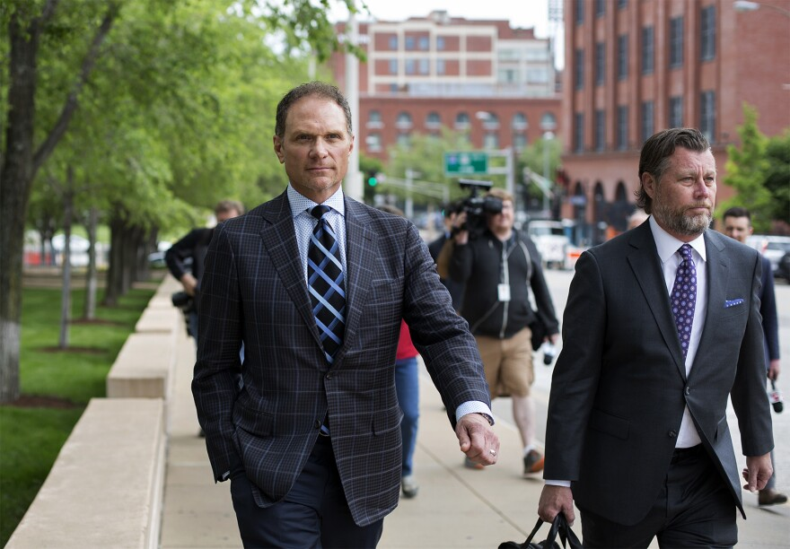 John Rallo (left), who allegedly received county contracts in exchange for campaign contributions to Stenger, leaves federal court with his attorney Friday afternoon.
