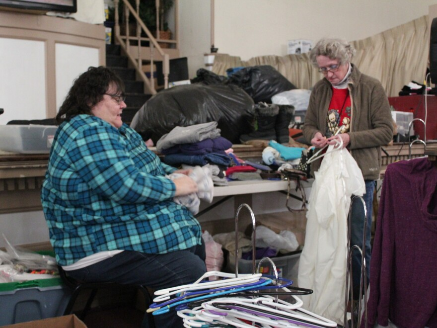 Roxanne Lent folds clothes for The Storehouse, a clothing ministry of Biker Church USA in Bangor, Maine.