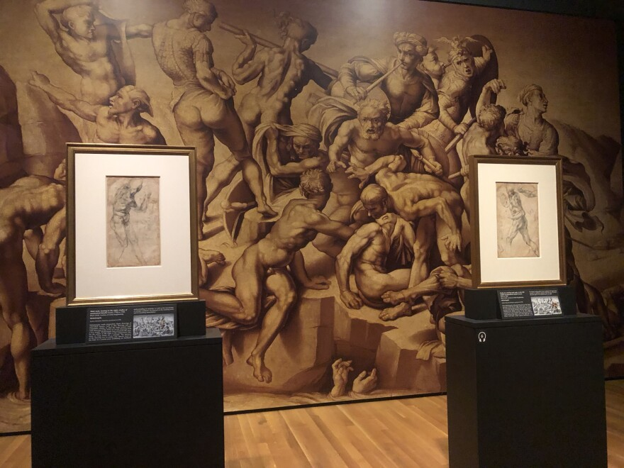 a photo of Michelangelo drawings and finished work