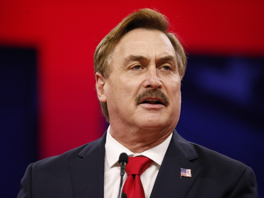 Mike Lindell, the CEO of My Pillow shown here during a 2019 conference, has been suspended from Twitter.